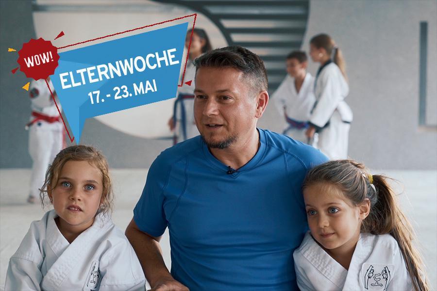 Vater mit zwei Mädchen im Arm